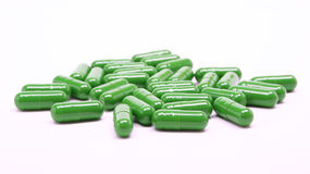 Green pills on white background Royalty Free Stock Images