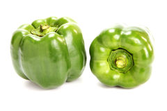 Green pimento. Two fresh pimentoes on the white background Stock Image