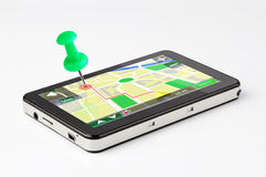 Green pin stuck in a GPS device. Travel destination, green pin stuck in a GPS device stock illustration