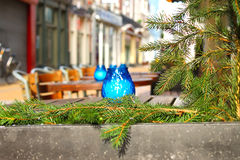 Green pine branch decorated street cafe Royalty Free Stock Photography
