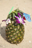 Green pineapple cocktail on the beach Stock Image