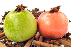 Green and pink apple with spices Stock Photos