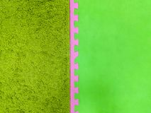 Green with a pink background, green carpet background. pink and green background.  stock photo