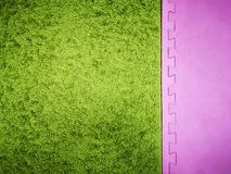 Green with a pink background, green carpet background. pink and green background.  royalty free stock photos