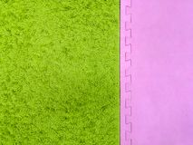 Green with a pink background, green carpet background. pink and green background.  royalty free stock image