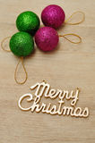 Green and Pink baubles with merry Christmas Stock Image