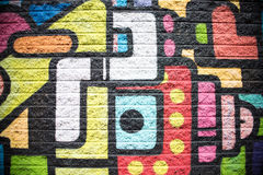 Green Pink Blue Red Orange Black Yellow Brick Wall Background. Painting Stock Photos