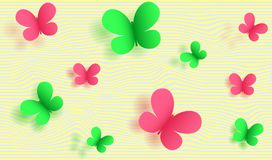 Green and pink butterflies on a striped background Royalty Free Stock Photos