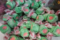 Green and Pink candy in a container royalty free stock image