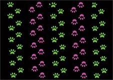 Green and pink footpads on black background Stock Photos