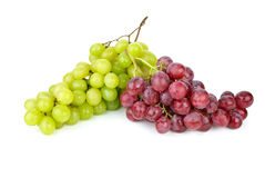 Green and pink grapes. Isolated on the white background Stock Images
