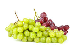 Green and pink grapes isolated on. The white background Stock Photos
