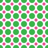 Green and Pink Polka Dots. A background pattern of alternating large green and small pink dots Stock Photography