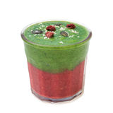Green pink smoothie in glassed with rapberry, pumpkin seeds and sesame on white. Green and pink smoothie in glassed with spinach, lemon, rapberry, pumpkin seeds Stock Photography