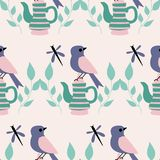 Green and pink teacups and birds