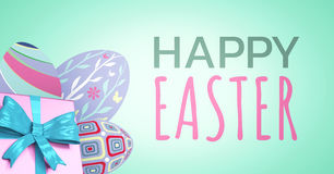 Green and pink type and pink gift and purple eggs against green background Stock Photography