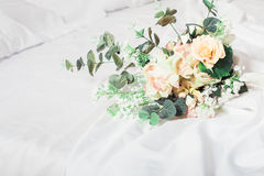 Green and pink wedding bouquet on the bed. Horizontal Royalty Free Stock Photography
