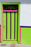 Green pink wooden door of a colonial house front Stock Photo