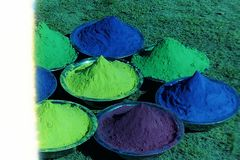 .......Green, pink, yellow, red color kept in cups for Holi-2. Green, pink, yellow, red color kept in cups for Holi stock photo