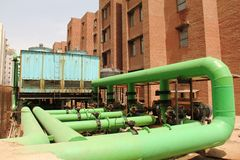 Green pipes for cooling water and tank. At Amity University, Greater Noida UP Stock Photos