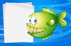 A green piranha beside an empty signboard. Illustration of a green piranha beside an empty signboard Royalty Free Stock Image