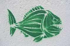 Green piranha graffiti on a wall Royalty Free Stock Photos