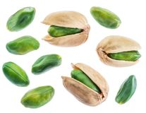 Green pistachio nuts isolated on white. Green pistachio nuts with pistachio shell on white background royalty free stock images