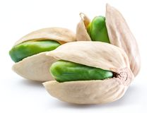 Green pistachio nuts with pistachio shell on white background. stock photography