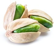Green pistachio nuts with pistachio shell on white background.  royalty free stock image