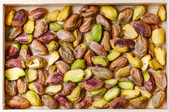 Green pistachio nuts without shell in a wooden box Royalty Free Stock Images