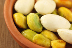 Green Pistachios with peeled almond Royalty Free Stock Photo