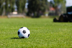 Green pitch with soccer ball Stock Images
