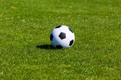Green pitch with soccer ball Stock Photography