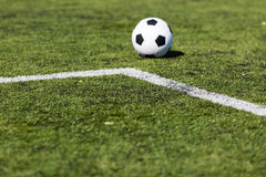 Green pitch with soccer ball Royalty Free Stock Photo