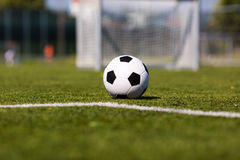 Green pitch with soccer ball Stock Photo