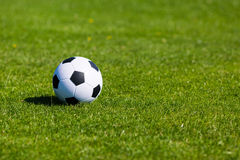 Green pitch with soccer ball Royalty Free Stock Photos