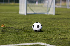 Green pitch with soccer ball Royalty Free Stock Image