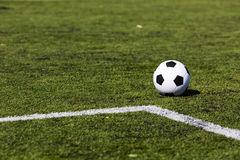 Green pitch with soccer ball Stock Photos
