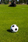 Green pitch with soccer ball Stock Image