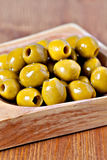 Green pitted marinated olives Royalty Free Stock Photography