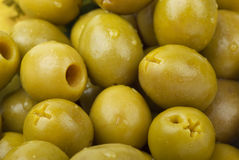 Green pitted olives Stock Photos
