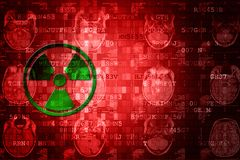 Green Pixelated Radiation icon on red digital background with copy space. Science concept Stock Photography