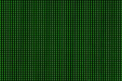 Green pixels lit up on a computer monitor stock photos