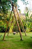 Green place with bamboo swings Royalty Free Stock Image