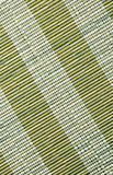 Green place mat, natural material texture. Stock Photos