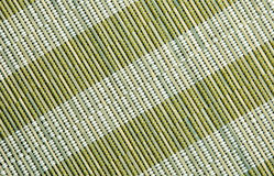 Green place mat, natural material texture. Royalty Free Stock Photos