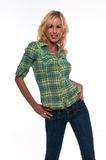 Green plaid. Pretty young blonde woman in a green plaid shirt and jeans Royalty Free Stock Photo