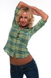 Green plaid. Pretty young blonde woman in a green plaid shirt and jeans Royalty Free Stock Images