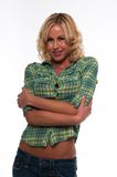 Green plaid. Pretty young blonde woman in a green plaid shirt and jeans Royalty Free Stock Photography