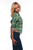 Green plaid. Pretty young blonde woman in a green plaid shirt and jeans Royalty Free Stock Photos